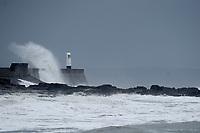 Pictured: Waves hit Porthcawl lighthouse in Bridgend, Wales, UK. Monday 17 September 2018<br /> Re: