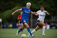 Seattle, Washington -  Sunday, September 11 2016: Seattle Reign FC forward Megan Rapinoe (15) goes against Washington Spirit defender Caprice Dydasco (3) during a regular season National Women's Soccer League (NWSL) match between the Seattle Reign FC and the Washington Spirit at Memorial Stadium. Seattle won 2-0.