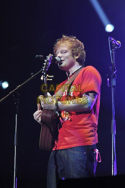 Ed Sheeran .Performing live at the 'Girlguiding UK  Big Gig' at Wembley Arena, London, UK, 1st October 2011..music concert  live on stage half length guitar playing red t-shirt microphone singing .CAP/MAR.© Martin Harris/Capital Pictures.