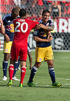 July 20, 2013: New York Red Bulls midfielder Tim Cahill #17 shakes hands with Toronto FC midfielder Matias Laba #20 at the end of a game between Toronto FC and the New York Red Bulls at BMO Field in Toronto, Ontario Canada.<br /> The game ended in a 0-0 draw.