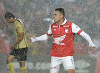 BOGOTÁ -COLOMBIA, 24-01-2014. Yulian Anchico jugador de Independiente Santa Fe celebra un gol en contra del Itaguí durante partido por la fecha 1 por la Liga Postobón  I 2014 jugado en el estadio Nemesio Camacho el Campín de la ciudad de Bogotá./ Independiente Santa Fe player Yulian Anchico celebrates a goal against Itagui during match for the 1st date for the Postobon  League I 2014 played at Nemesio Camacho El Campin stadium in Bogotá city. Photo: VizzorImage/ Gabriel Aponte / Staff