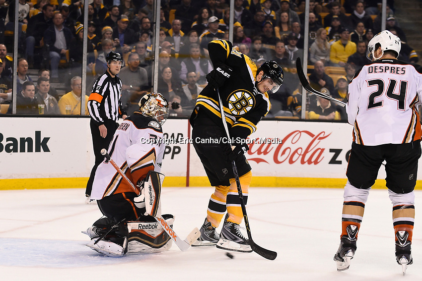 March 26, 2015 - Boston, Massachusetts, U.S. - Boston Bruins left wing Loui Eriksson (21) tries to redirect the puck in front of Anaheim Ducks goalie Frederik Andersen (31) during the NHL match between the Anaheim Ducks and the Boston Bruins held at TD Garden in Boston Massachusetts. Boston fell to Anaheim 3-2 in overtime. Eric Canha/CSM