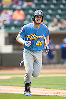 Billy McKinney (20) of the Myrtle Beach Pelicans hustles down the first base line against the Winston-Salem Dash at BB&T Ballpark on May 10, 2015 in Winston-Salem, North Carolina.  The Pelicans defeated the Dash 4-3.  (Brian Westerholt/Four Seam Images)