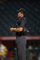 Home plate umpire Shin Koishizawa during an Arizona League game between the AZL Athletics and the AZL Angels at Tempe Diablo Stadium on June 26, 2018 in Tempe, Arizona. The AZL Athletics defeated the AZL Angels 7-1. (Zachary Lucy/Four Seam Images)