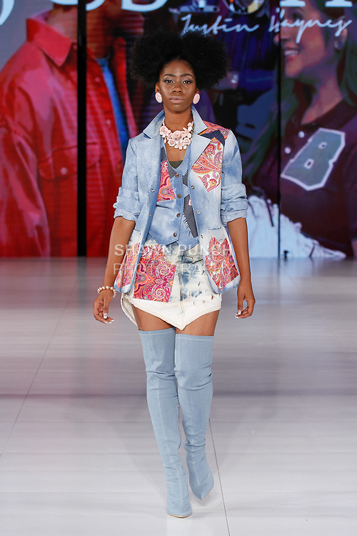 Model walks runway in an outfit from the Jus 10H collection by Justin Haynes, during Society Fashion Week Spring Summer 2019 in New York City on September 7, 2018.