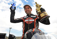 Jul, 22, 2012; Morrison, CO, USA: NHRA pro stock motorcycle rider Eddie Krawiec celebrates after winning the Mile High Nationals at Bandimere Speedway. Mandatory Credit: Mark J. Rebilas-US PRESSWIRE