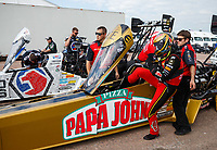 Apr 22, 2017; Baytown, TX, USA; NHRA top fuel driver Leah Pritchett (near) climbs into her dragster alongside teammate Antron Brown during qualifying for the Springnationals at Royal Purple Raceway. Mandatory Credit: Mark J. Rebilas-USA TODAY Sports