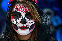 A young woman, dressed as La Catrina, a Mexican pop culture icon representing the Death, performs during the Day of the Dead procession in Mexico City, Mexico, 29 October 2016. Day of the Dead (Día de Muertos), a syncretic religious holiday combining the death veneration rituals of the ancient Aztec culture with the Catholic practice, is celebrated throughout all Mexico. Based on the belief that the souls of the departed may come back to this world on that day, people gather at the gravesites in cemeteries praying, drinking and playing music, to joyfully remember friends or family members who have died and to support their souls on the spiritual journey.