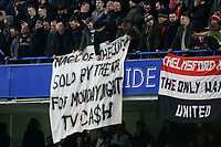 Manchester United fans with a banner Magic of the Cup, sold by the FA for Monday night TV cash during Chelsea vs Manchester United, Emirates FA Cup Football at Stamford Bridge on 18th February 2019