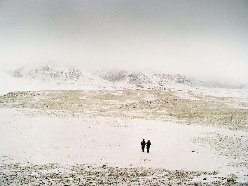 """Ghulam Ustad's sons looking for their sheep herd's return..Campment of the """"second"""" Sary Tash. Ustad's Ghulam's camp..Winter expedition through the Wakhan Corridor and into the Afghan Pamir mountains, to document the life of the Afghan Kyrgyz tribe. January/February 2008. Afghanistan"""