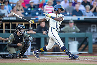 Michigan Wolverines outfielder Christian Bullock (5) follows through on his swing against the Vanderbilt Commodores during Game 1 of the NCAA College World Series Finals on June 24, 2019 at TD Ameritrade Park in Omaha, Nebraska. Michigan defeated Vanderbilt 7-4. (Andrew Woolley/Four Seam Images)