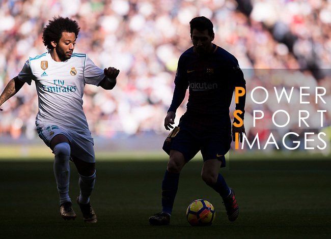 Lionel Andres Messi (R) of FC Barcelona fights for the ball with Marcelo Vieira Da Silva of Real Madrid during the La Liga 2017-18 match between Real Madrid and FC Barcelona at Santiago Bernabeu Stadium on December 23 2017 in Madrid, Spain. Photo by Diego Gonzalez / Power Sport Images