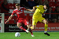 Joe Pritchard of Accrington Stanley battles for the ball with Ched Evans of Fleetwood Town during the The Leasing.com Trophy match between Accrington Stanley and Fleetwood Town at the Fraser Eagle Stadium, Accrington, England on 3 September 2019. Photo by Greig Bertram / PRiME Media Images.