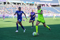 Orlando, Florida - Sunday, May 8, 2016: Seattle Reign FC defender Elli Reed (7) takes on Orlando Pride defender Monica Hickman Alves (21) during a National Women's Soccer League match between Orlando Pride and Seattle Reign FC at Camping World Stadium.