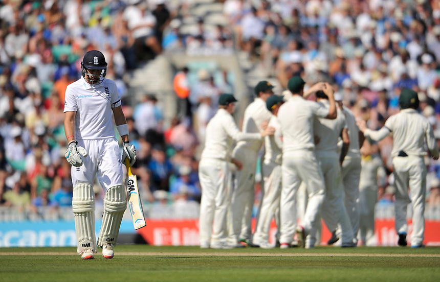 England's Joe Root dejected after being out caught by Australia's Mitchell Starc off the bowling of Mitchell Johnson for 11<br /> <br /> Photographer Ashley Western/CameraSport<br /> <br /> International Cricket - Investec Ashes Test Series 2015 - Fifth Test - England v Australia - Day 3 - Saturday 22nd August 2015 - Kennington Oval - London<br /> <br /> &copy; CameraSport - 43 Linden Ave. Countesthorpe. Leicester. England. LE8 5PG - Tel: +44 (0) 116 277 4147 - admin@camerasport.com - www.camerasport.com