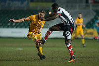 Sid Nelson of Newport County and Akwasi Asante of Grimsby during the Sky Bet League 2 match between Newport County and Grimsby Town at Rodney Parade, Newport, Wales on 14 February 2017. Photo by Mark  Hawkins / PRiME Media Images.