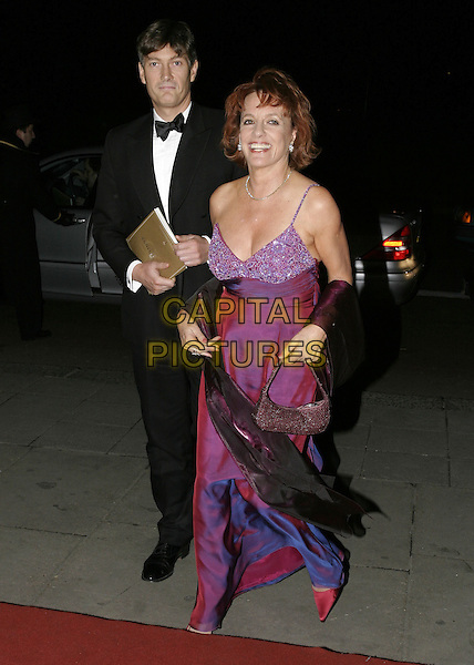 ESTHER RANTZEN.Official BAFTA Aftershow Dinner Party, .Grosvenor House, Park lane, London, .February 12th 2005..full length purple red dress broken strap.Ref: AH.www.capitalpictures.com.sales@capitalpictures.com.©Capital Pictures.