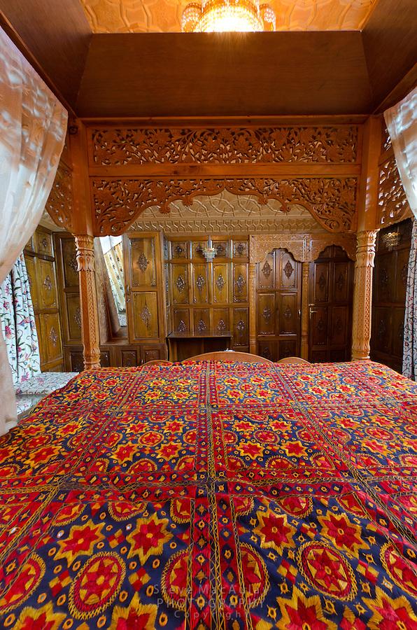 Interior views of master bedroom on traditional Kashmiri houseboat, Dal Lake, Srinagar, Kashmir, India.