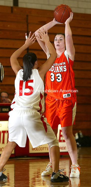 WOLCOTT, CT, 01/13/08- 011309BZ10-  Watertown's Hannah Collier (33) looks for the pass against Wolcott's Jen Catone (15)Tuesday night.<br />  Jamison C. Bazinet Republican-American