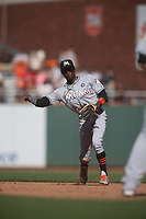 SAN FRANCISCO, CA - JULY 9:  Dee Gordon #9 of the Miami Marlins makes a play at second base against the San Francisco Giants during the game at AT&T Park on Sunday, July 9, 2017 in San Francisco, California. (Photo by Brad Mangin)