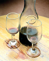 STILL LIFE: NEGATIVE IMAGE OF WINE. Carafe of Wine With Smeared & Tumbled Glasses.