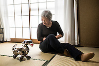 Michiko Sakurai with her AIBO at home in Japan. In 1999, Sony released a series of robotic pets called AIBO or Artificial Intelligence Robot. In 2006, they discontinued the AIBO line and then in 2014, discontinued all reparair services on the AIBO. A small community of AIBO owners still exists and a new repair service has emerged to help keep the AIBOs running.