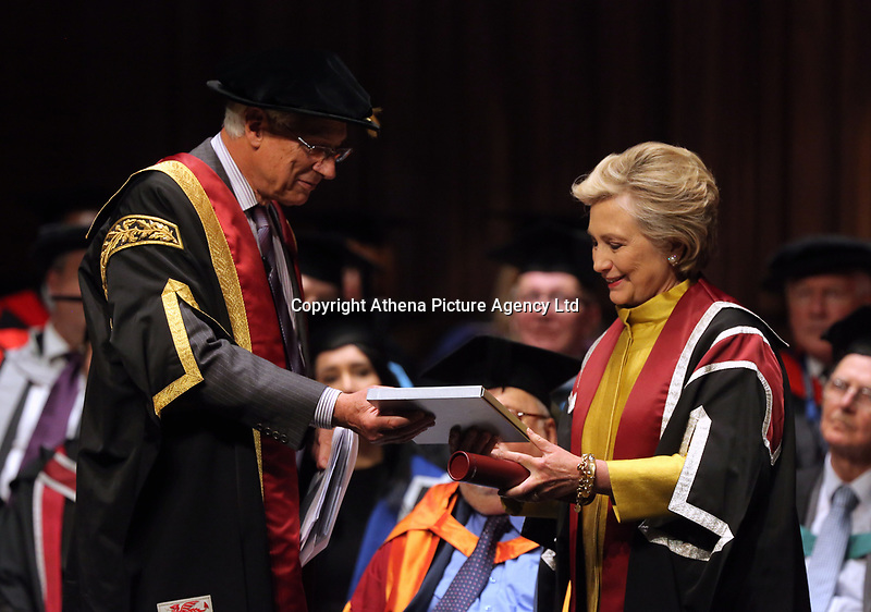 Pictured: Hillary Clinton (R) is handed a commemorative book about her family history at Swansea University Bay Campus. Saturday 14 October 2017<br />Re: Hillary Clinton, the former US secretary of state and 2016 American presidential candidate will be presented with an honorary doctorate during a ceremony at Swansea University's Bay Campus in Wales, UK, to recognise her commitment to promoting the rights of families and children around the world.<br />Mrs Clinton's great grandparents were from south Wales.