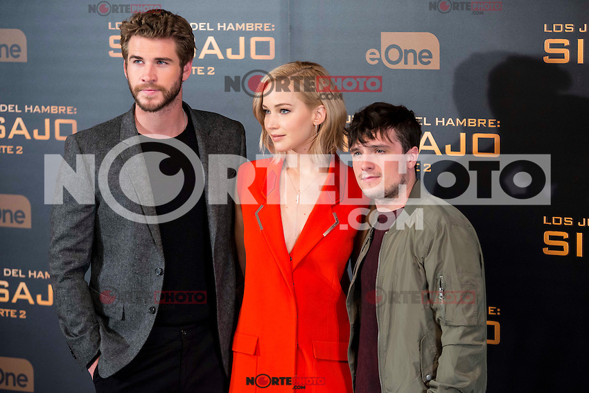 Star cast, actor Liam Hemsworth (L), actress Jennifer Lawrence (C) and actor Josh Hutcherson (R) during the presentation of film &quot;The Hunger Games: Sinsajo Part 2&quot; in Madrid, Novermber 10, 2015.<br /> (ALTERPHOTOS/BorjaB.Hojas)