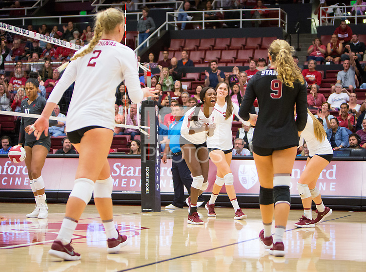 STANFORD, CA - October 12, 2018: Kathryn Plummer, Tami Alade, Audriana Fitzmorris, Morgan Hentz at Maples Pavilion. No. 2 Stanford Cardinal swept No. 21 Washington State Cougars, 25-15, 30-28, 25-12.