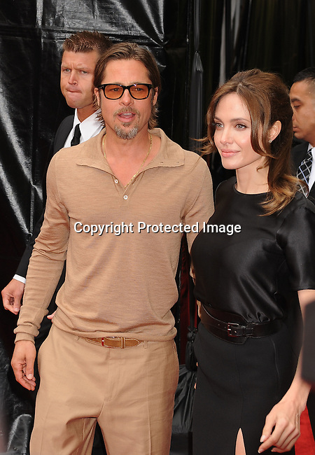 "HOLLYWOOD, {CA} -MAY 22: Brad Pitt and Angelina Jolie arrive at the Los Angeles premiere of ""Kung Fu Panda 2"" held at Grauman's Chinese Theatre on May 22, 2011 in Hollywood, California."