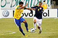 Colombian player Macnelly Torres (R ) fights for the ball with Brazilian player Paulinho during their friendly match at MetLife Stadium in East Rutherford New Jersey, November 14, 2012. Photo by Eduardo Munoz Alvarez / VIEWpress.