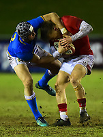 Wales U20's Callum Carson is tackled high by Italy U20's Andrea de Masi<br /> <br /> Photographer Richard Martin-Roberts/CameraSport<br /> <br /> Six Nations U20 Championship Round 4 - Wales U20s v Italy U20s - Friday 9th March 2018 - Parc Eirias, Colwyn Bay, North Wales<br /> <br /> World Copyright &not;&copy; 2018 CameraSport. All rights reserved. 43 Linden Ave. Countesthorpe. Leicester. England. LE8 5PG - Tel: +44 (0) 116 277 4147 - admin@camerasport.com - www.camerasport.com