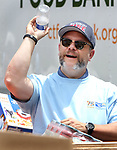 WATERBURY CT. 21 June 2017-062117SV05-Frank Monteiro of MacDermid Performance Solutions, campaign co-chairman, during the United Way's 75th annual Day of Action in Waterbury Wednesday. They were collecting food items for the Connecticut food bank.<br /> Steven Valenti Republican-American