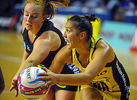 Samantha Sinclair marks Liana Leota during the ANZ Netball Championship match between the Central Pulse and Waikato Bay Of Plenty Magic at TSB Bank Arena, Wellington, New Zealand on Monday, 30 March 2015. Photo: Dave Lintott / lintottphoto.co.nz