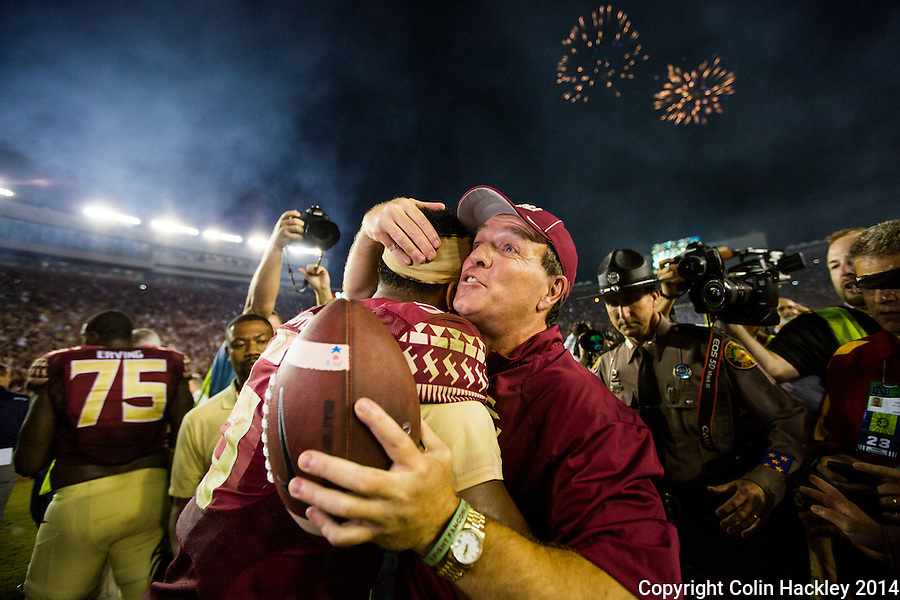 TALLAHASSEE, FLA. 10/18/14-FSU-ND101814CH-Florida State Head Coach Jimbo Fisher, right, embraces quarterback Jameis Winston after the Seminoles beat the Fighting Irish 31-27 Saturday at Doak Campbell Stadium in Tallahassee.<br /> COLIN HACKLEY PHOTO