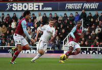 Barclays Premier League, West Ham United (red)V Swansea City Fc (white), Boelyn Ground, 02/02/13<br /> Pictured: This pass threaded through the West Ham defense nearly saw Ben Davies through on goal<br /> Picture by: Ben Wyeth / Athena Picture Agency<br /> info@athena-pictures.com