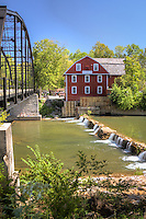 War Eagle Mill is a working gristmill in Benton County, Arkansas. A mill has been located on the site as early as 1832, but was destroyed three times, and last rebuilt in 1973. The mill currently the only operating mill in Arkansas and operates as an undershot gristmill, and houses a store and the Bean Palace restaurant. The mill is home to the War Eagle mill Crafts Fair in May and October.  The historic War Eagle Bridge next to the mill is a one lane steel bridge built in 1907 and is listed on the National Register of Historic Places.  The bridge was restored, preserving the historic intergrety in 2010. The mill is located approximately 10 miles east of the city of Rogers in War Eagle, Arkansas.