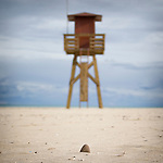 A watch tower on a sandy beach