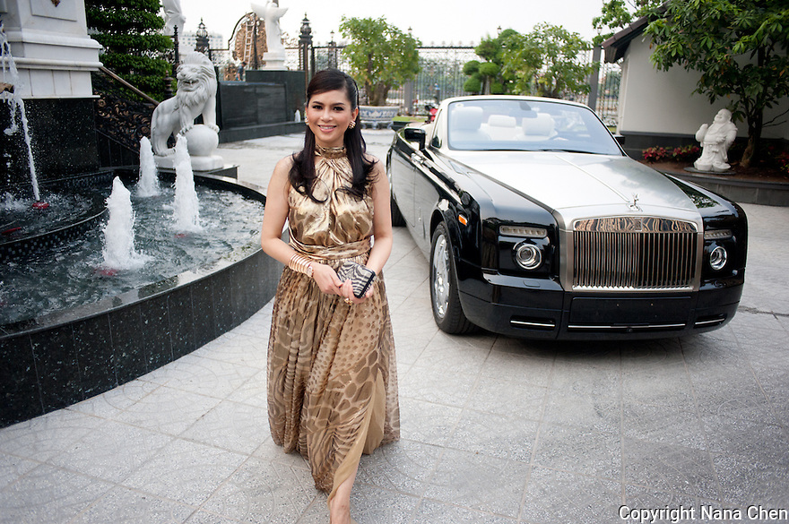 Former film actress and one of Vietnam's wealthiest women, Thuy Tien is the president of Imex Pan Pacific, a trading company that runs over 26 major businesses, including shopping malls, duty free fashion designer boutiques. Pictured here at the front of her high security riverside villa in Anphu, Saigon, a residential enclave with rich Vietnamese and expats.