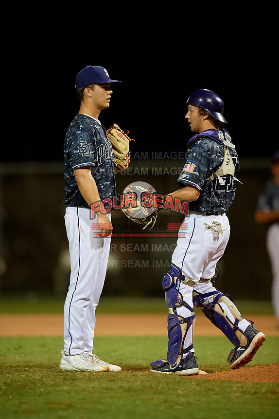 Pitcher Joseph Charles talks with catcher Brooks Rikeman during the WWBA World Championship at the Roger Dean Complex on October 19, 2018 in Jupiter, Florida.  Joseph Charles is a right handed pitcher from Celebration, Florida who attends The First Academy and is committed to North Carolina.  Brooks Rikeman is a catcher from Winter Park, Florida who attends Orangewood Christian School and is committed to Jacksonville.  (Mike Janes/Four Seam Images)