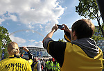 Bayern Munich 2 Borussia Dortmund 1, 25/05/2013. Wembley Stadium, Champions League Final. The first all-German Champions League final pitched Bayern, dominent domestically all season, against a Dortmund team who have troubled them so often in recent years. A Dortmund supporter takes a snap shot of Wembley way. Photo by Simon Gill.