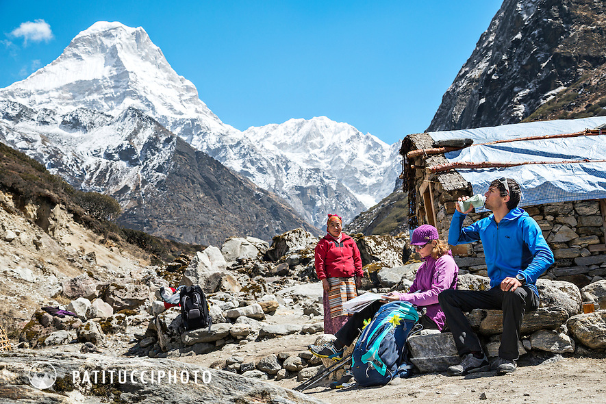 Trekkers stopped at a small Nepalese store on the Mera Peak Trail, Nepal Himalaya.