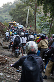 INDONESIA, Flores, mortorbikes pass after a roadblock opens on the Transflores Hwy, the road to Momare