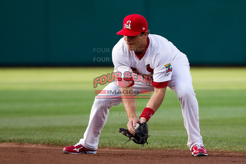 Eric Duncan (15) of the Springfield Cardinals fields a ground ball during a game against the Tulsa Drillers on April 29, 2011 at Hammons Field in Springfield, Missouri.  Photo By David Welker/Four Seam Images.