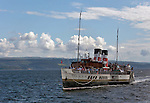 PS Waverley arrives at Dunoon, Scotland on her way up the Clyde. The Waverley is the last seagoing passenger Paddle Steamer in the World.