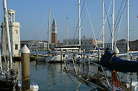 The marina on the Island of San Giorgio Maggiore,in the background, the Campanile of St Marks square and Palazzo Ducale, Venice, Italy. May 2007.