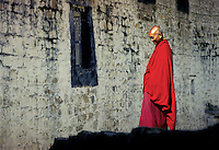 By the late tenth and early eleventh centuries, Buddhism slowly began to gain influence as Tibetan lamas traveled and studied in India while actively building new monasteries that later developed into sub-sects of Tibetan Buddhism. Prior to 1951, the three great monastic universities of Lhasa housed over fifteen thousand monks and nearly ten percent of all Tibetans were monks or nuns..