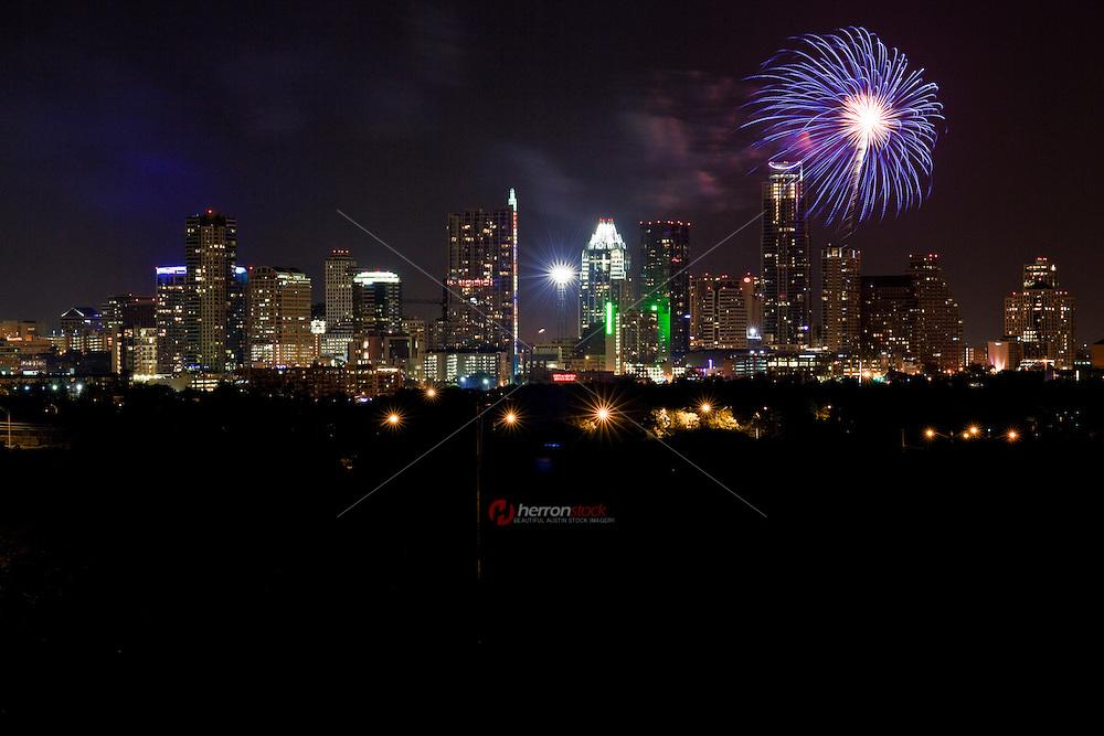 Fireworks shooting over Downtown New Skyline Austin, Texas Cityscape