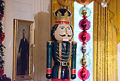 """The 2016 White House Christmas decorations are previewed for the press at the White House in Washington, DC on Tuesday, November 29, 2016. This nutcracker stands in the southeast corner of the East Room.  The first lady's office released the following statement to describe those decorations, """"This year's holiday theme, 'The Gift of the Holidays,' reflects on not only the joy of giving and receiving, but also the true gifts of life, such as service, friends and family, education, and good health, as we celebrate the holiday season.""""<br /> Credit: Ron Sachs / CNP"""