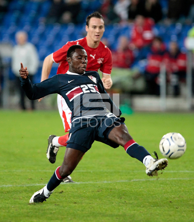 USA midfielder (25) Freddy Adu plays the ball in front of Switzerland defender (25) Steve Von Bergen. The United States Men's National Team (USA) defeated Switzerland (SUI) 1-0 during an international friendly at St. Jakob Park, Basel, Switzerland, on October 17, 2007.